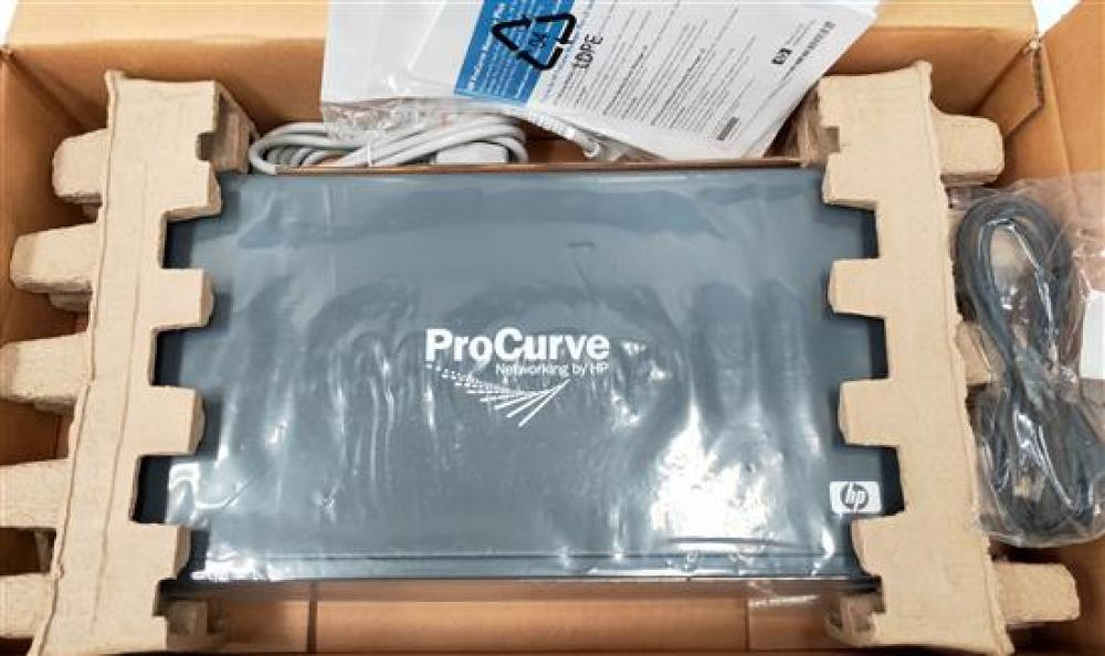 A network device marked HP ProCurve in open box