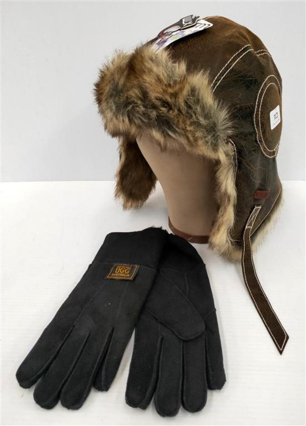 A pair of fur line gloves marked UGG & winter hat XTM one size