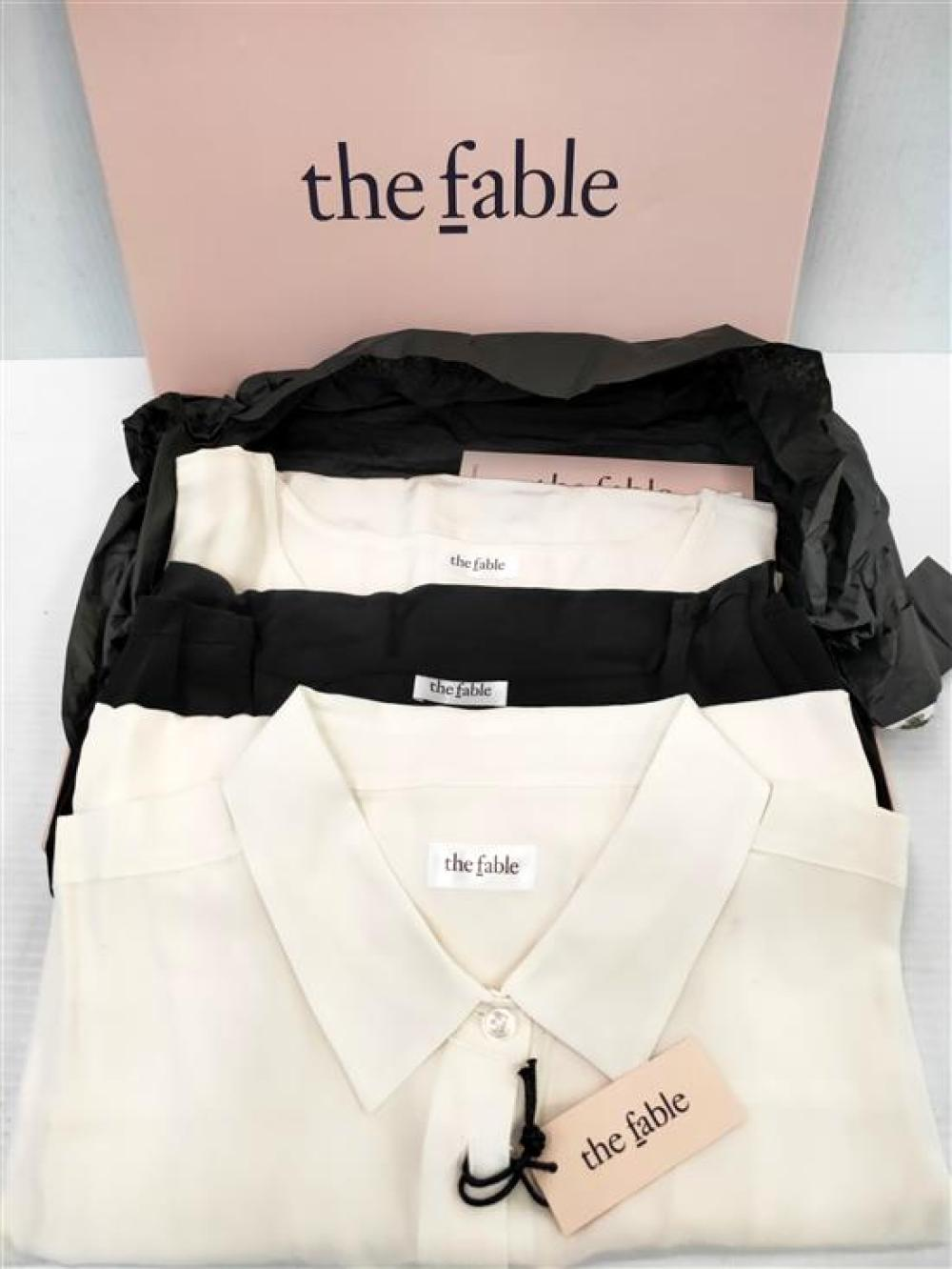 Three women's silk shirts & tops marked The Fable, one Size L (two white, one black)