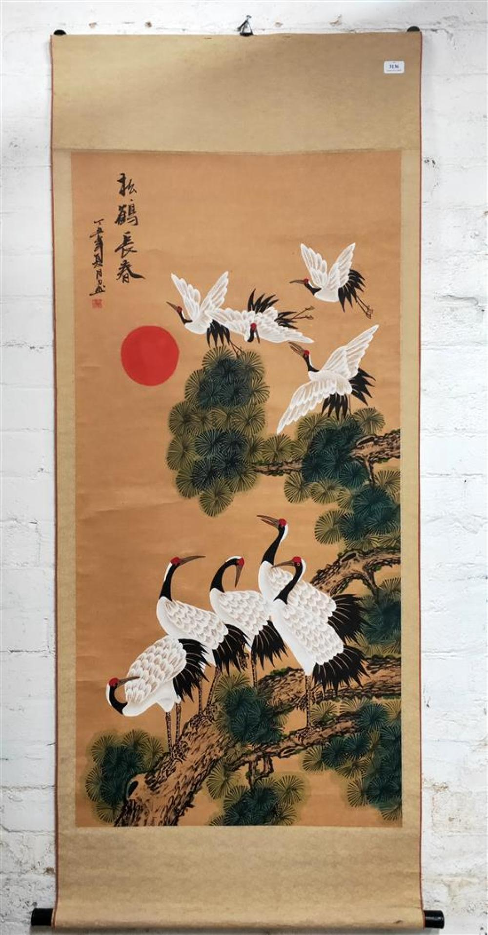 A Chinese Scroll depicting red crested cranes flying over Pine tree