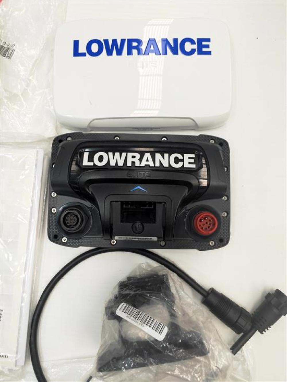 A fish finder marked Lowrance Elite 5TI in open box, used