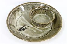 An Earthenware Glazed Platter with Molded Dip-Bowl