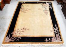A Fine Large Chinese Fringed Rug with Cream Mat within a Black Border, auspicious symbols in each corner,