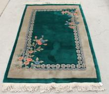 A Chinese Wool Rug in Jade Green with Stone Grey Border and Floral Sprays on Two Corners,
