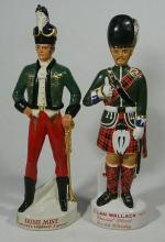Two Tall Ceramic Figurine Whisky Decanters,