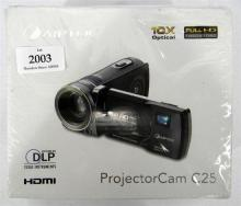An Aiptek Projector cam C25 in sealed, but slightly damaged box