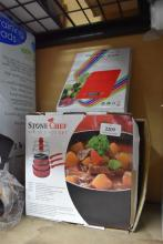 A Stone Chef set of three pots in open box with electronic kitchen scale
