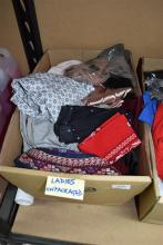 A box of ladies unpackaged clothing