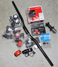 A quantity of bicycle accessories incl. handle bar, cleats, lights etc.