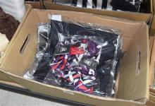 A box of NJ Bale corporate skirts & accessories