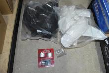 A box of motorcycle plastics & other accessories