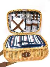 A Wicker Picnic Basket with Plates & Cutlery