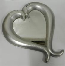 A Silvered Heart Shaped Mirror