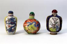 Three Snuff Bottles, an Enamel & Two Porcelain,19th/20th Century,