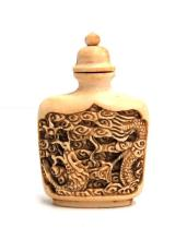 A Carved Ivory Snuff Bottle, Dragon on Front & Phoenix on Reverse