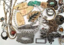 A Collection of Costume Jewellery including Necklaces, Brooches, Bangles, Shirt Clips,