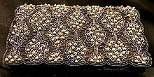 A Black and Silver Beaded Purse