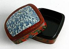 An Oriental Red Lacquer Trinket Box with Blue and White Qing Shard
