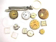 A Collection of Watch Parts including Dials, Glasses,