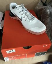 A pair of womens sports shoes marked Nike Metcon 4, size 42.5 with box