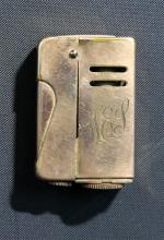 A Vintage Australian Gold Plated Lighter by Preslite
