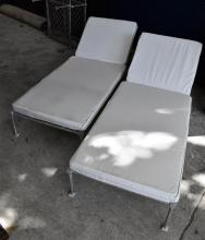 A Pair of Metal Adjustable Sun Lounges with White Cushions