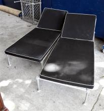 A Pair of Metal Adjustable Sun Lounges with Black Cushions