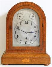 A Wooden Cased Pendulum Mantle Clock with Key,