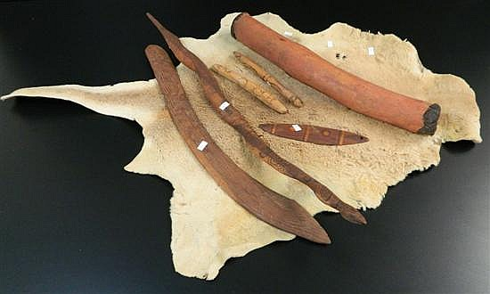 One tanned kangaroo skin, one central Australian boomerang (broken)