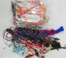A Bag of Beaded Necklaces plus a Bag of Rakhi Jewellery
