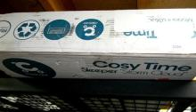 A Portable Bassinet marked Cosytime in resealed box + booster seat