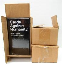 A Cards Against Humanity Game Set plus Blue & Green Expansion Sets