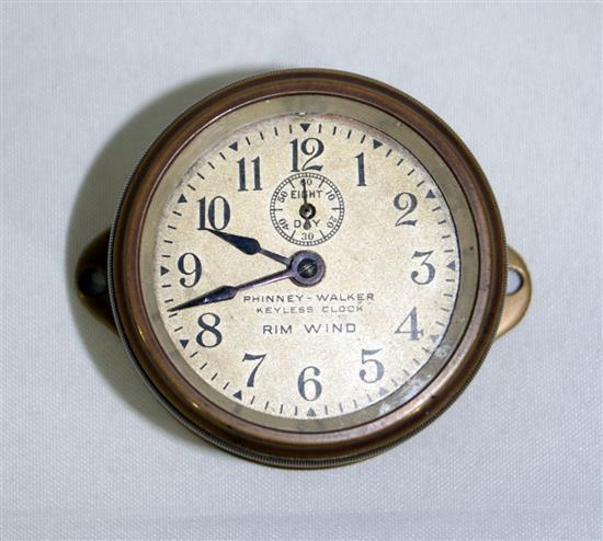 A veteran brass dash mounted rim wind clock by Phinney-Walker, circa 1915