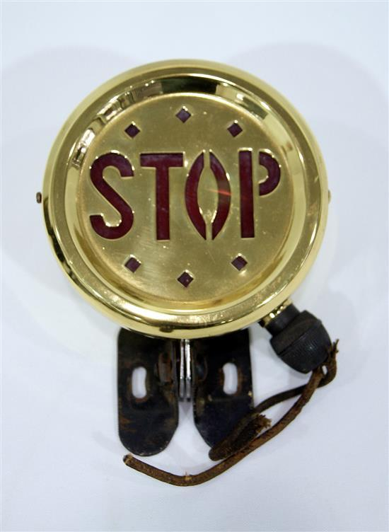 A vintage brass accessory stop light