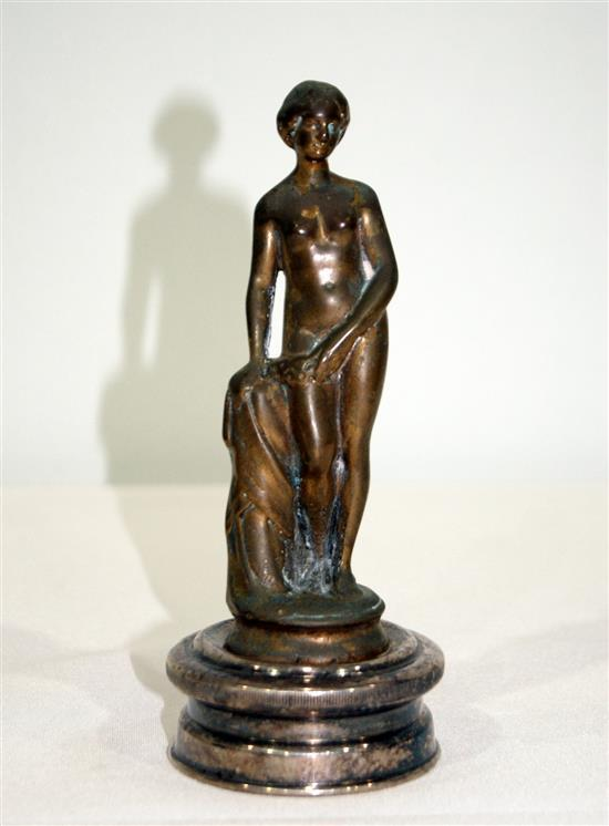 A bronze nymph on radiator cap
