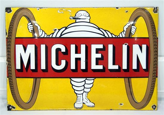 A convex enamel Michelin sign featuring Mr Bibendum