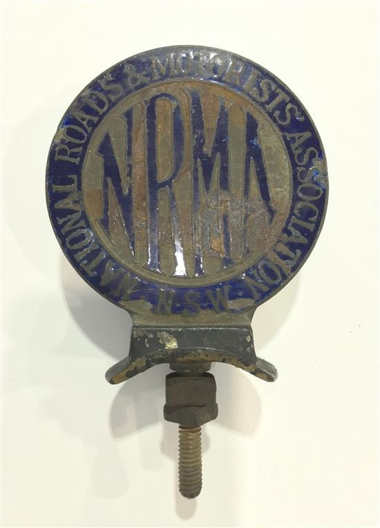 An early NRMA enamel car badge