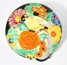 A Ceramic Plaque with a Brightly Coloured Parrot, Surrounded by Flowers, circa 1930