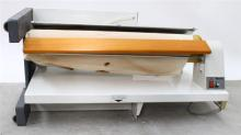 A Miele 855 Ironing Machine with Manual