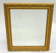 A Rectangular Gold Framed Mirror