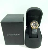 A ladies wrist watch marked Emporio Armani with packaging