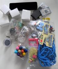 Two bags incl. keyrings, jewellery making components, pins, boxes & rakhi