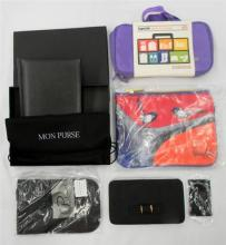 The travel pack incl. RFID passport holder, diary plus bags marked Napoleon & Lapoche etc.