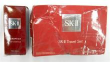 A travel set & Genoptics Spot Essence marked SK-II, as found