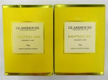 Two scented candles marked Glasshouse