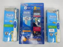Two Oral-B electric tooth brushes plus replacement head kit