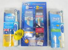 Two Oral-B electric toothbrushes & replacement head kit