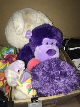 A box of assorted plush toys