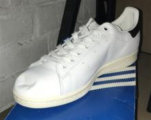 A pair of mens sports shoes marked Adidas Stan Smith size 42 2/3 with box