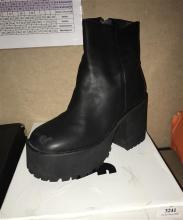 A pair of womens platform boots marked Unif size 39 with box